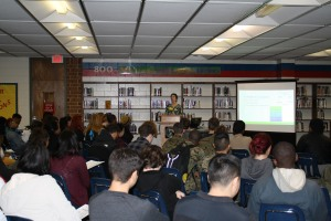 Denise Woetzel presents to college-bound English classes at Hermitage High School.