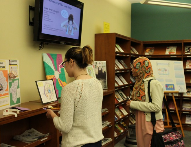 Students view Expo projects at the Parham Campus Library
